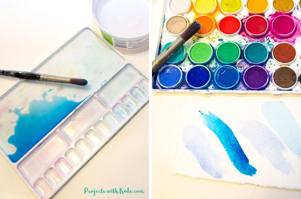 Mixing blue watercolor paint.