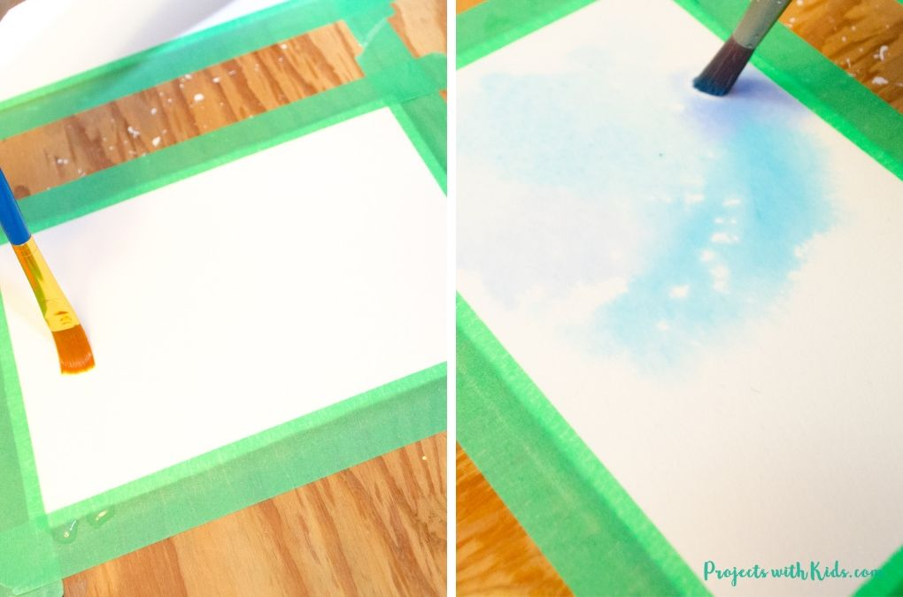 Painting watercolor paper with water and blue paint.