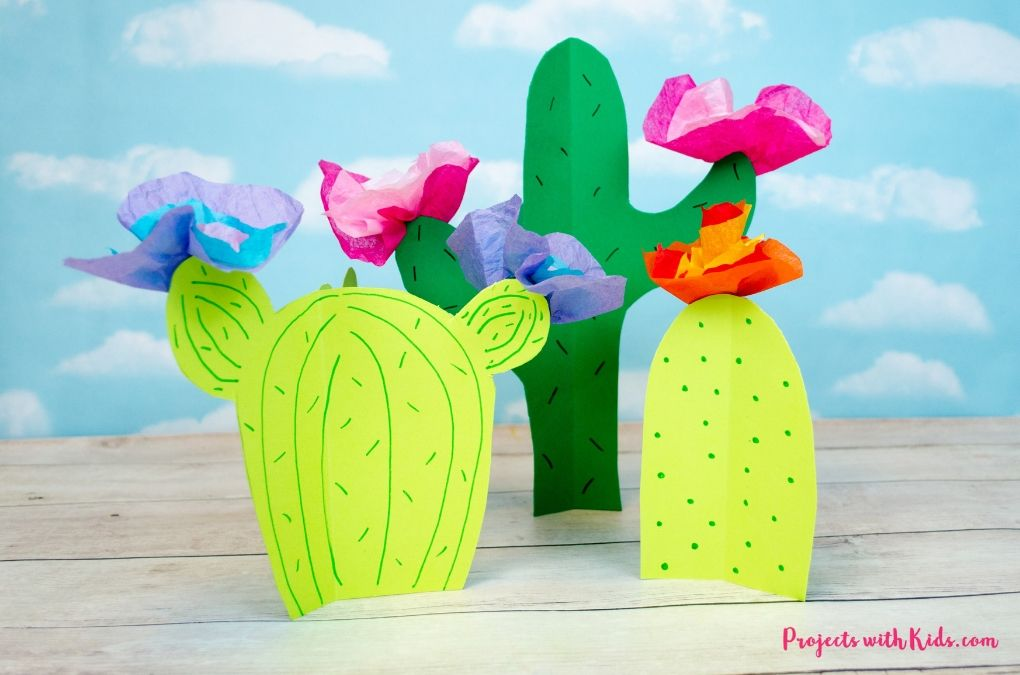 3D paper cactus craft with tissue paper flowers.