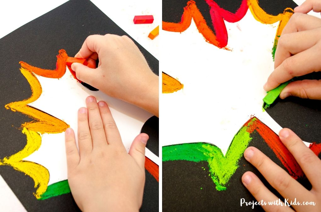 Drawing around a leaf template with chalk pastels in fall colors.