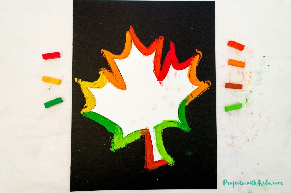 Image of pastel line drawing around a maple leaf template in autumn colors.