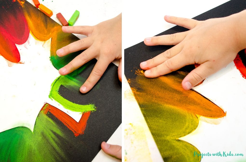 Using fingers to smudge chalk pastels.