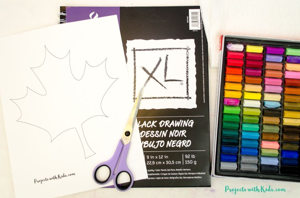Supplies needed to make a chalk pastel leaf art project: chalk pastels, black drawing paper, scissors and leaf printable.