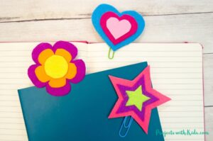 3 colorful felt bookmarks in a heart shape, star and flower shape with 2 notebooks.