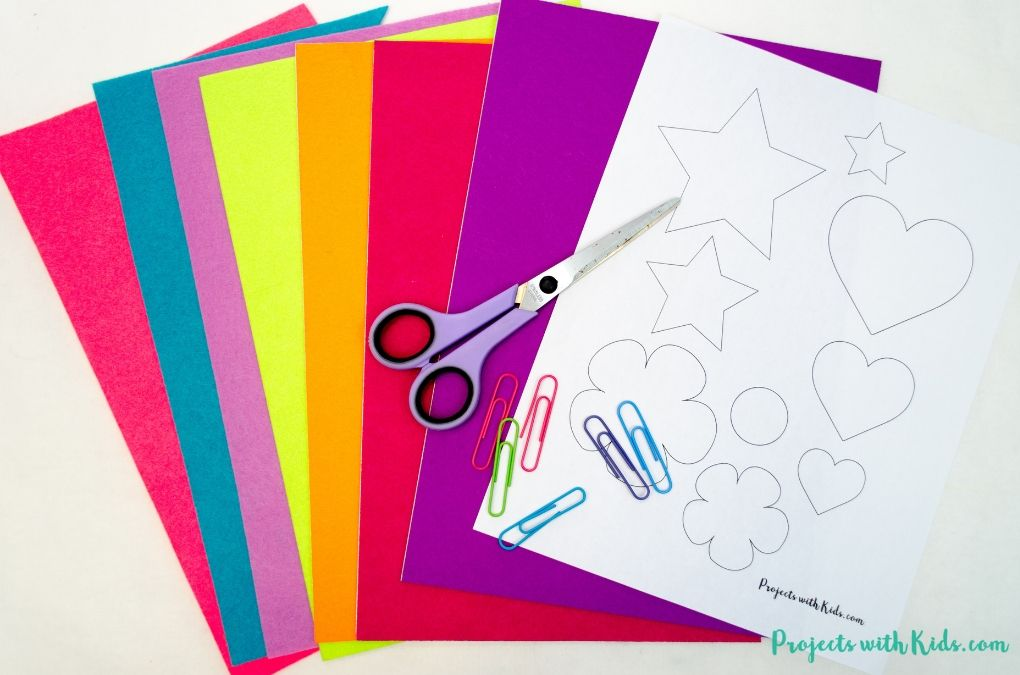 Supplies needed for making simple shape felt bookmarks. Felt sheets, scissors, paper clips, printable template.
