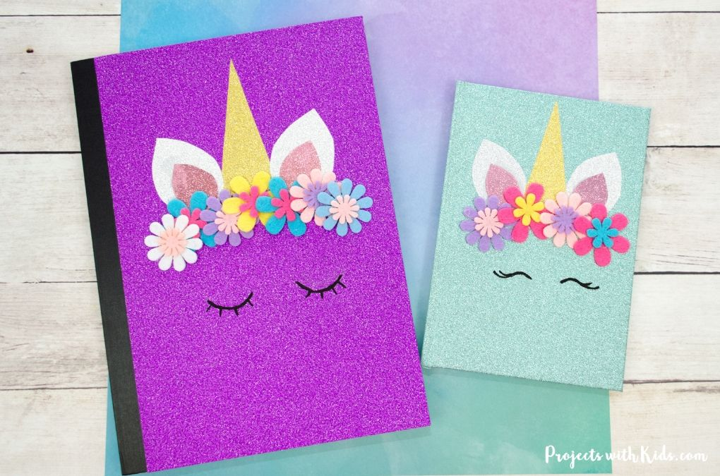 2 diy unicorn notebooks, 1 purple and 1 blue