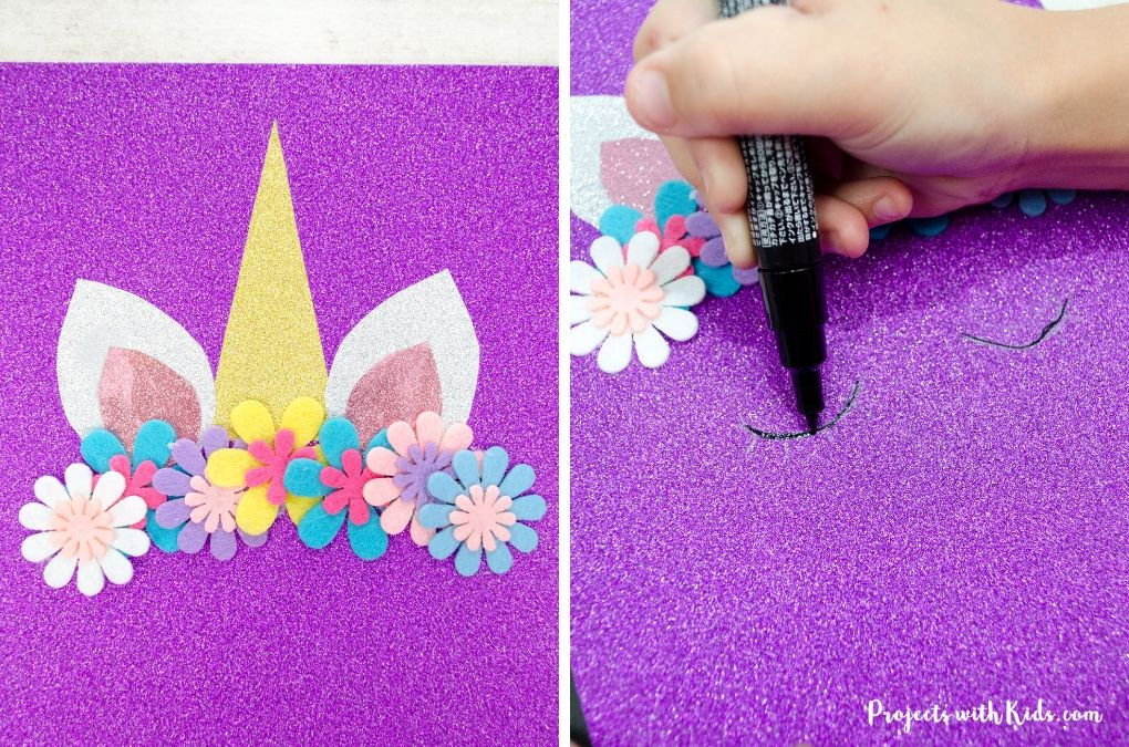 Drawing on unicorn eyes with a paint pen on a purple sparkly notebook