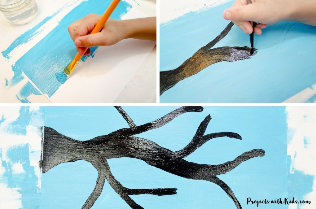 Painting a blue sky and painting a tree branch black.