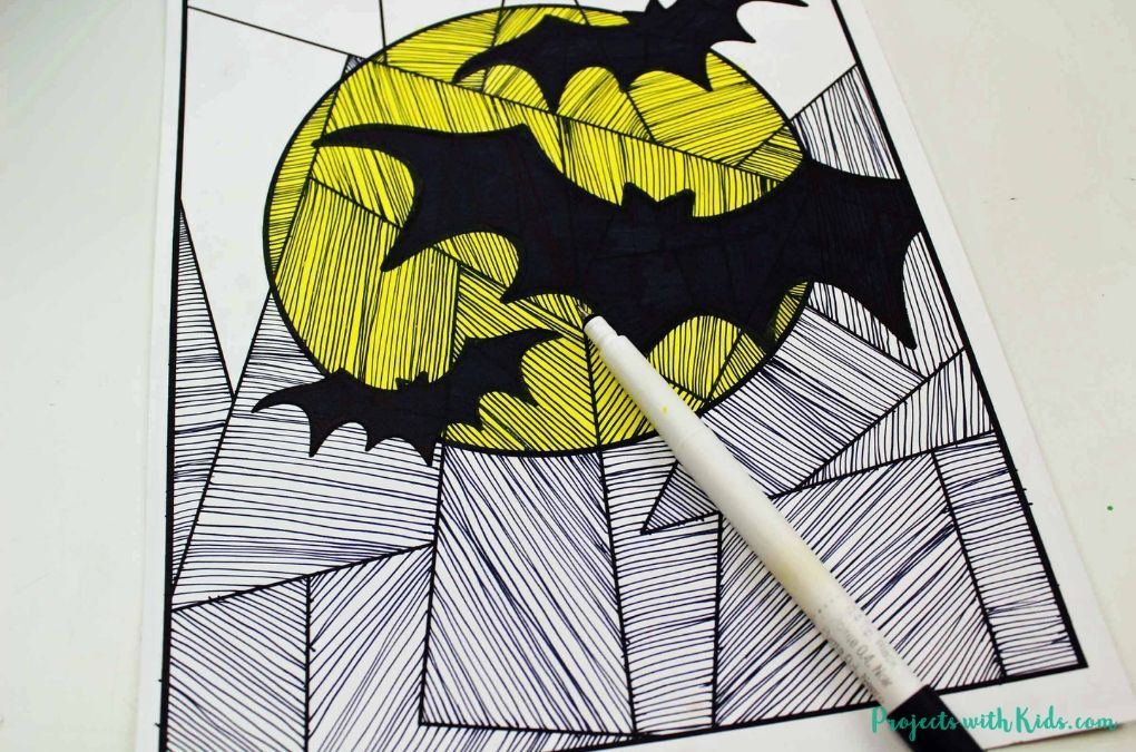 Black lines drawn on white paper with a yellow full moon and black bats.