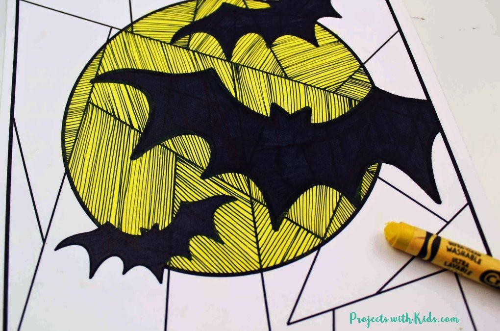 Colored in yellow moon and black bats on white paper.