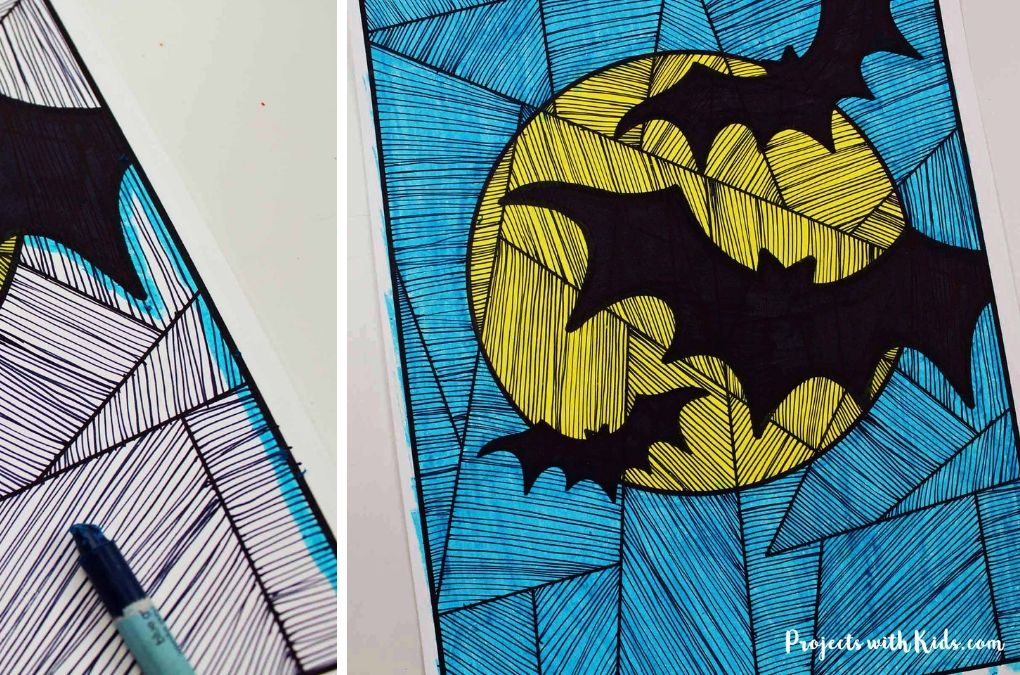 Halloween bat art project: Blue colored background with yellow full moon and black bats