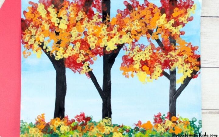 fall forest painting using bundled q-tips to create the leaves