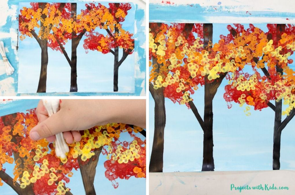 Painting yellow fall leaves with q-tips on a fall art project