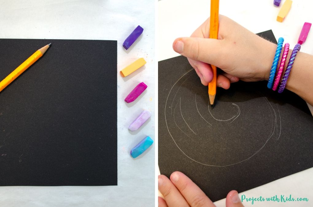 Drawing a spiral with pencil on black paper