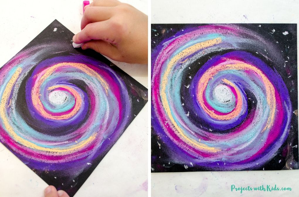 Adding stars to a galaxy sky with white chalk pastel