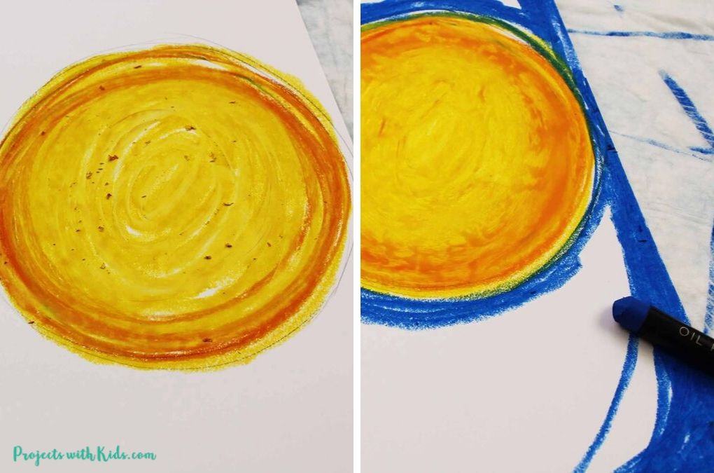 Full moon drawing with orange and yellow oil pastels, coloring the background with blue oil pastels.