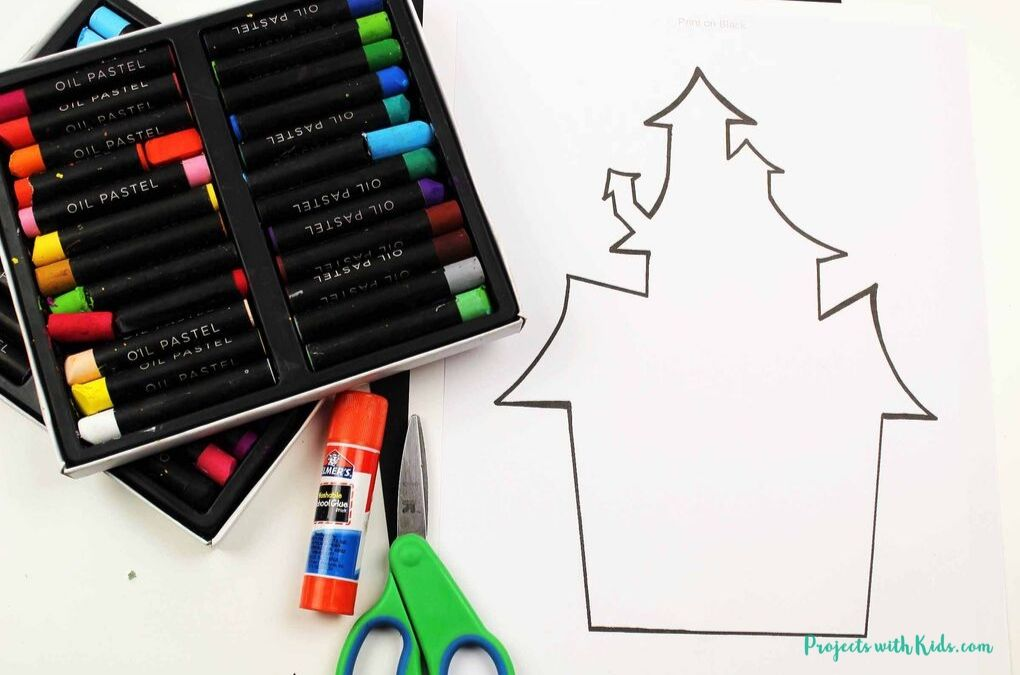 oil pastels, glue stick, scissors and printable of a haunted house.
