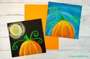 Pumpkin chalk pastel art - 2 ways. One pumpkin with a bright blue sky and one pumpkin with a full moon starry sky.