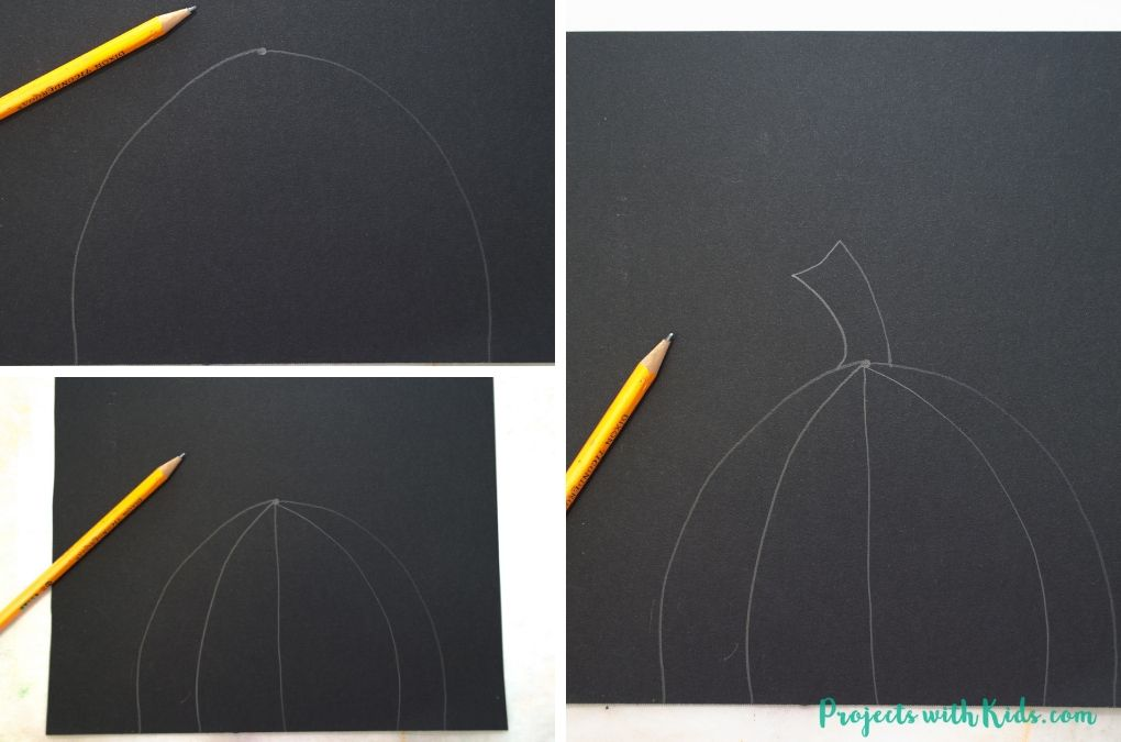 Drawing a pumpkin on black paper.