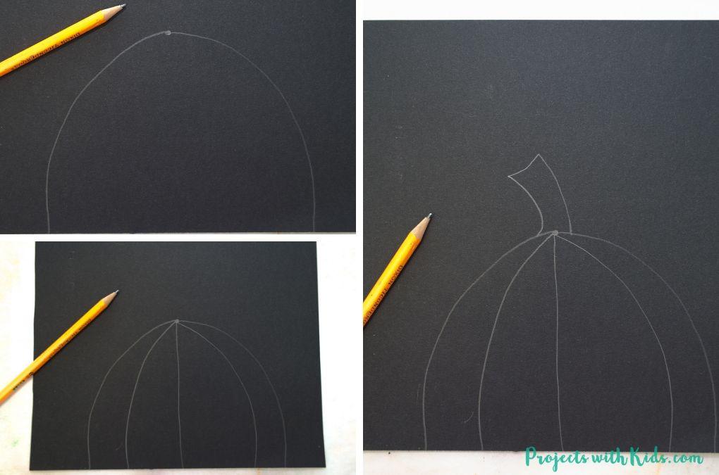Drawing a pumpkin on black paper.