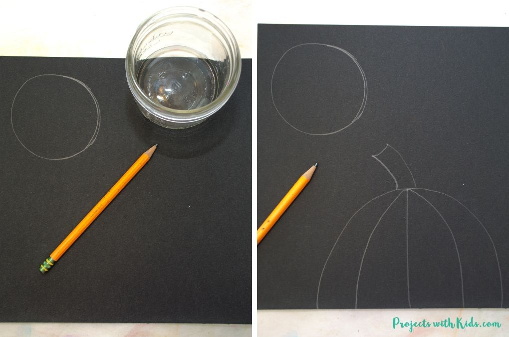 Using a glass to draw in a full moon on black paper.