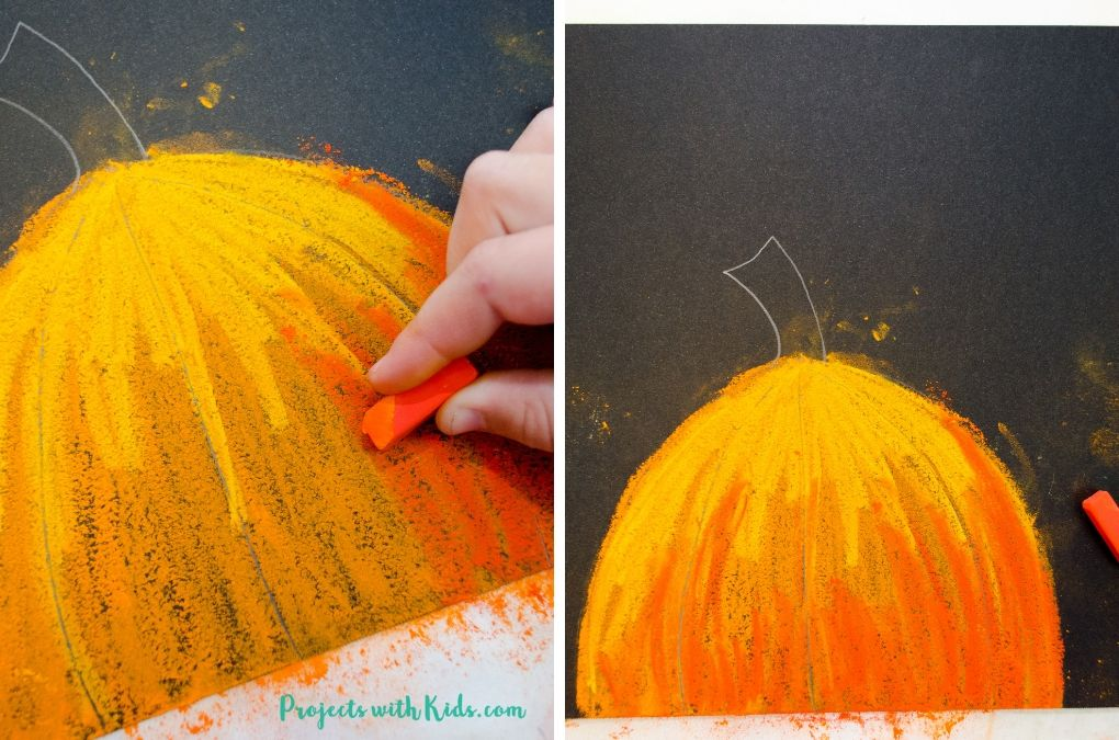 Adding in darker orange chalk pastel to the bottom of a pumpkin for a fall art project.