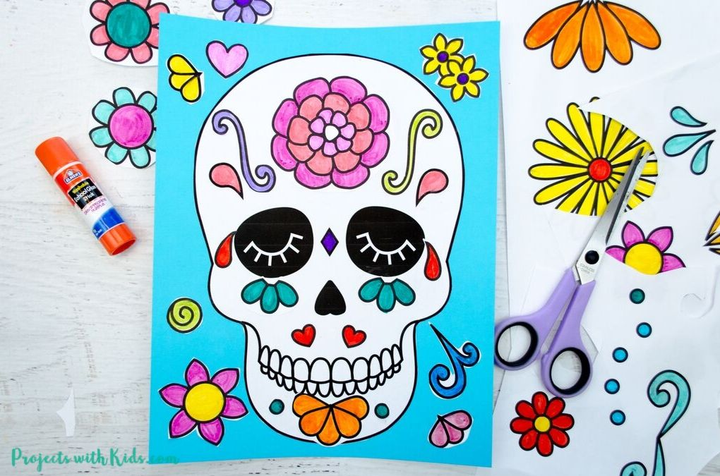 Paper cutouts glued to a blank sugar skull