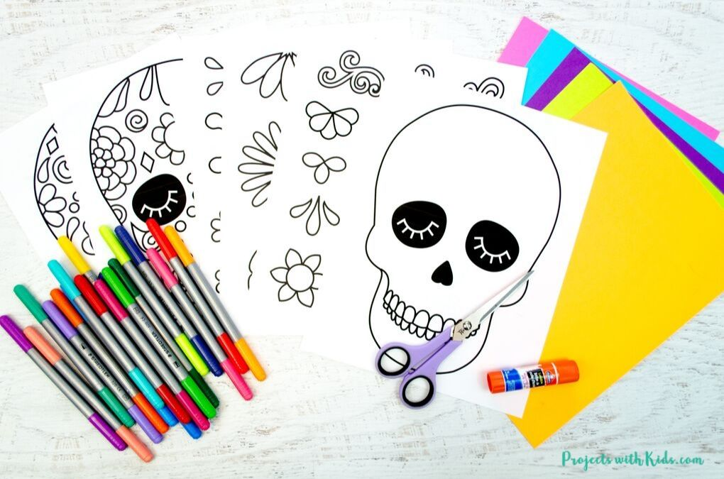 Sugar skull printables, markers, scissors, glue stick, colored cardstock