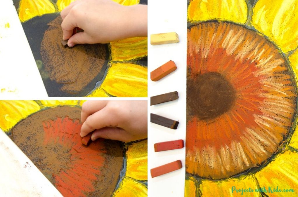 Using brown chalk pastels to color in the centre of a sunflower art project