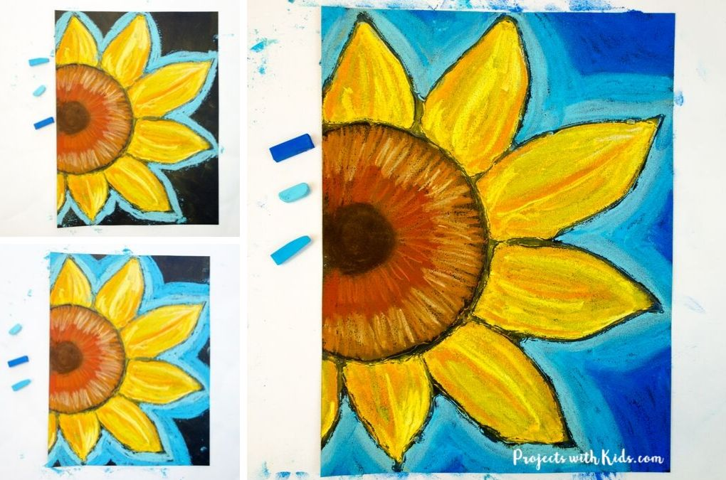 Coloring blue pastel around a sunflower chalk pastel drawing