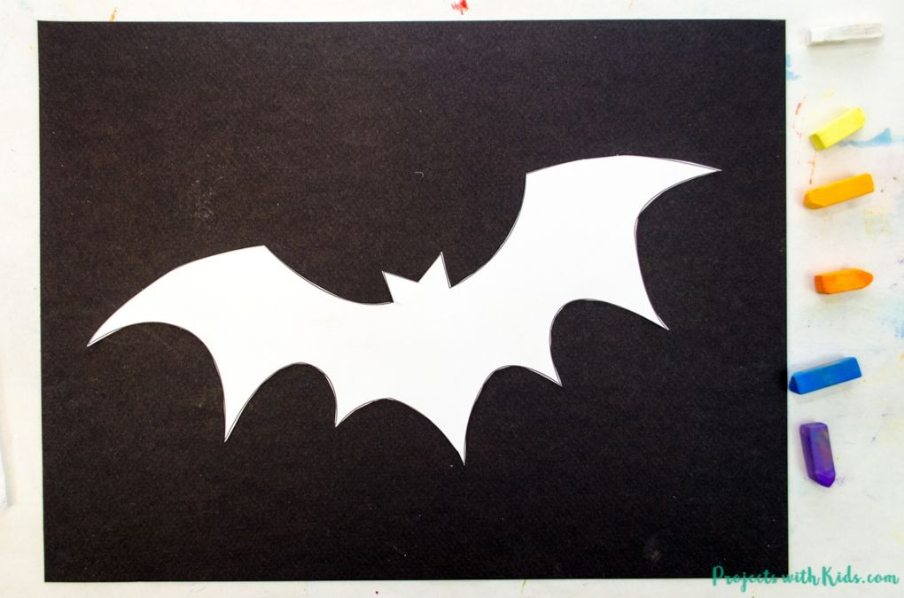 Bat template cut out and taped to black paper