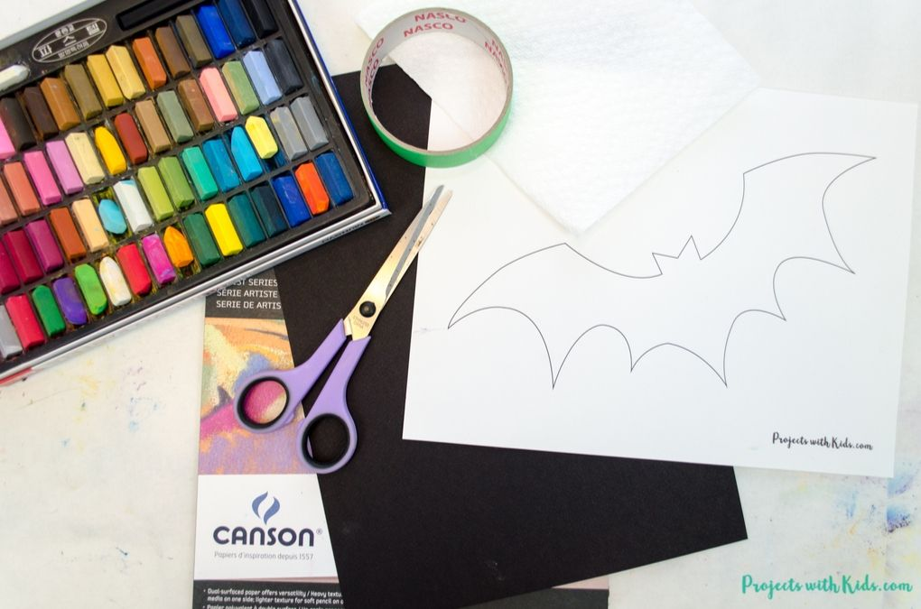 Supplies to create a bat art project with chalk pastels