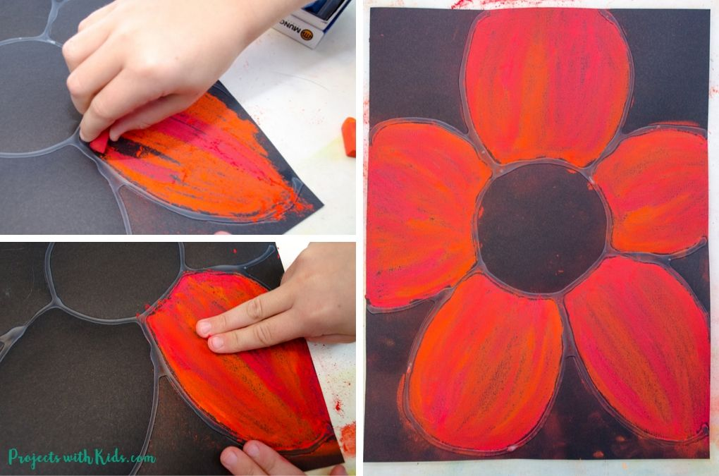 Drawing with red chalk pastels on black paper