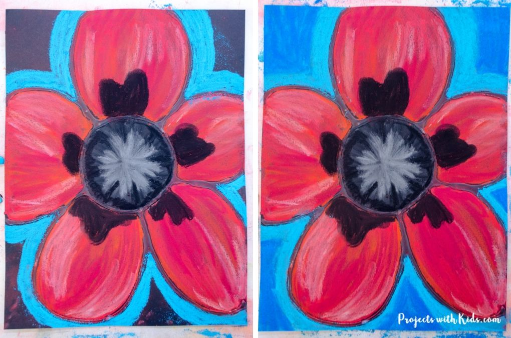 Adding bright blue colors to the background of a poppy pastel drawing