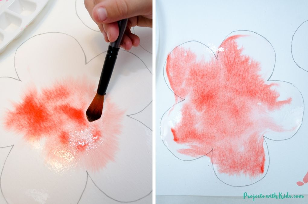 Painting with red watercolors using a wet on wet technique