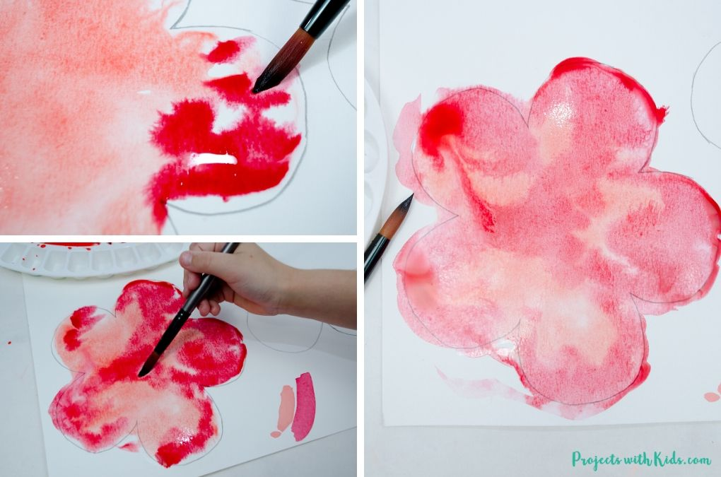 Painting with 2 shades of red watercolor paint using a wet on wet technique