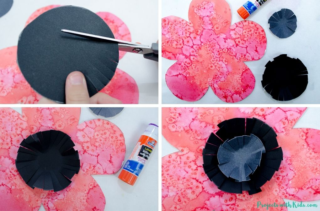 Cutting and glueing black and grey paper circles to a poppy painting