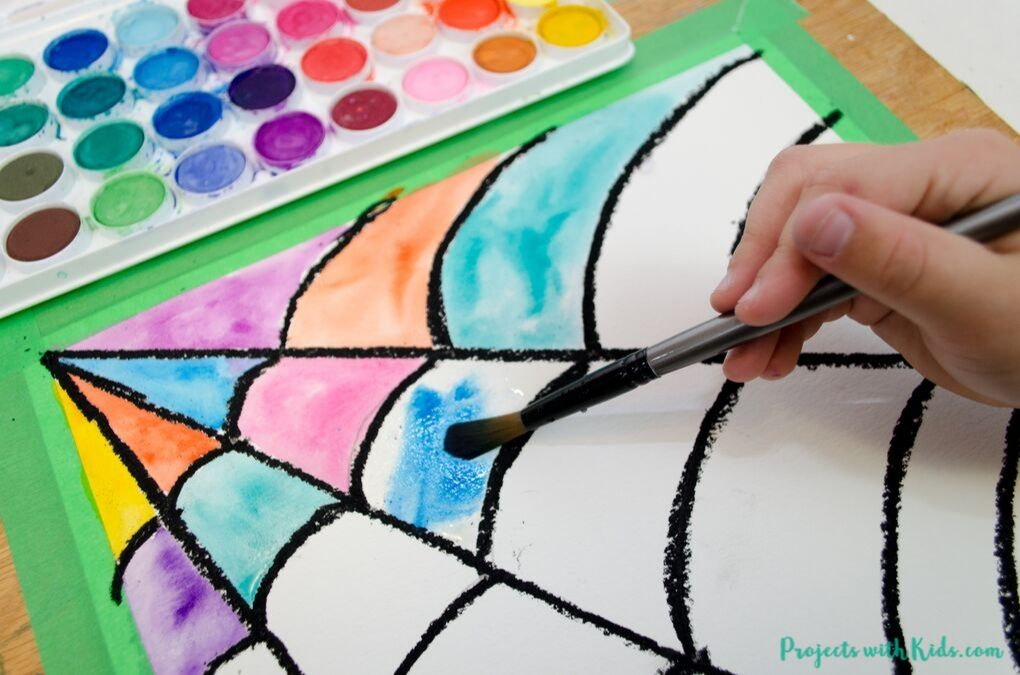 Painting in a spider web drawing with watercolor paint