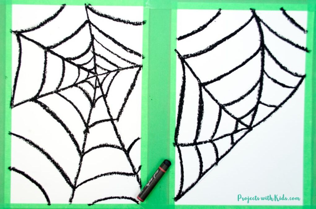 Spider web designs drawn with black oil pastels
