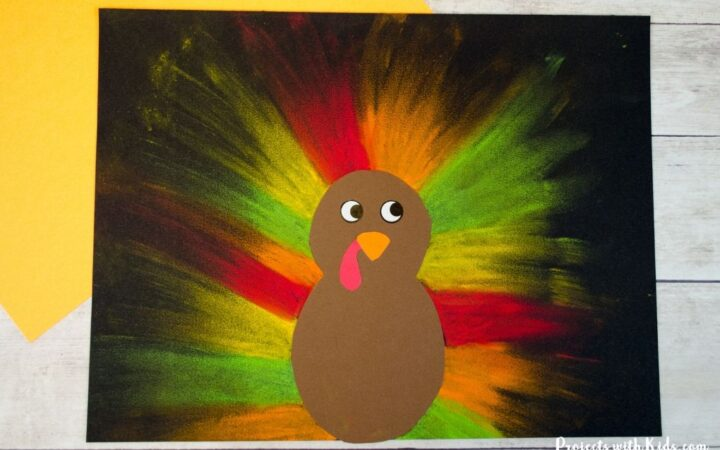 chalk pastel turkey craft on black paper