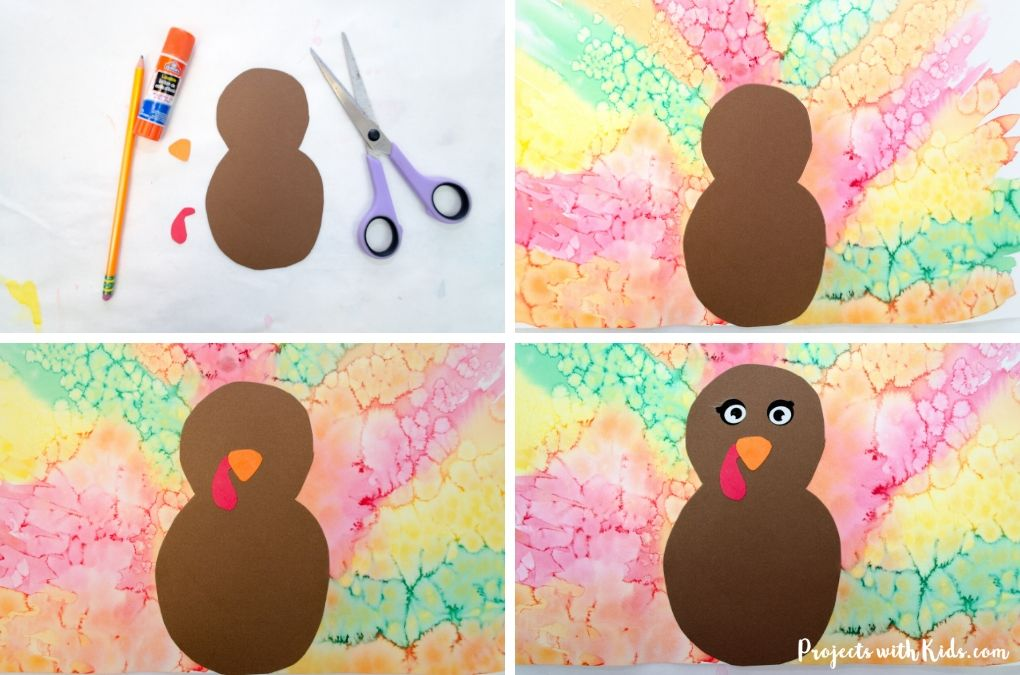 Glueing on the turkey body, eyes, and beak of a watercolor turkey craft for kids