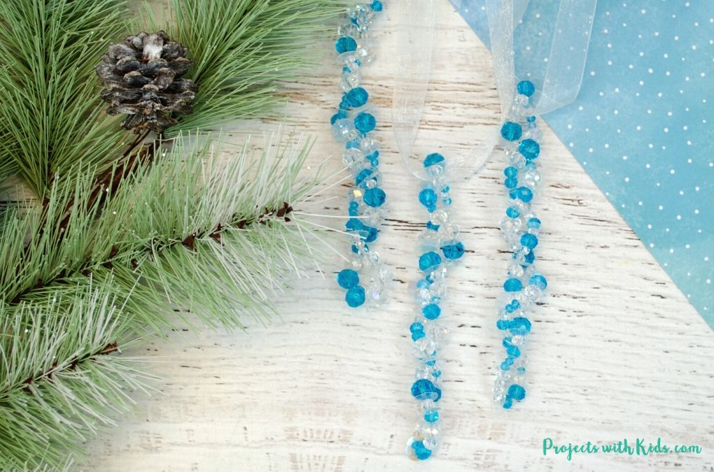 Blue and clear beaded icicle ornaments craft for kids to make.