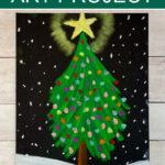 Chalk pastel Christmas tree on black paper.