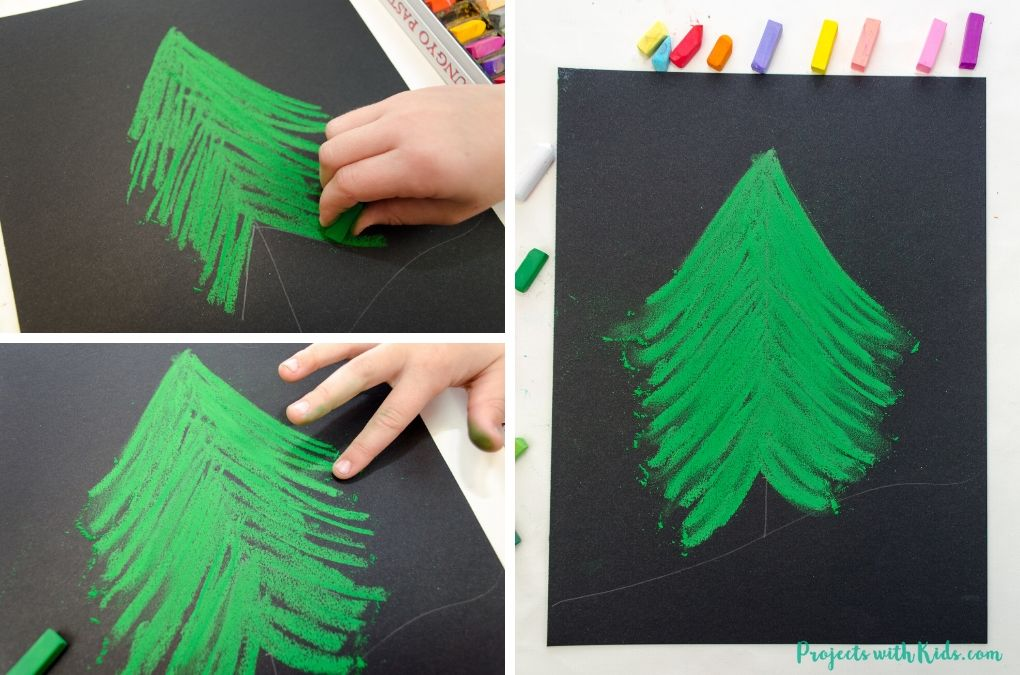 Drawing a christmas tree with green chalk pastel
