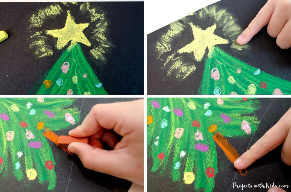 Drawing a star on the top of a Christmas tree and adding a tree trunk with chalk pastels.
