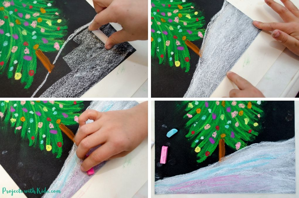 Drawing snow with chalk pastels on black paper.