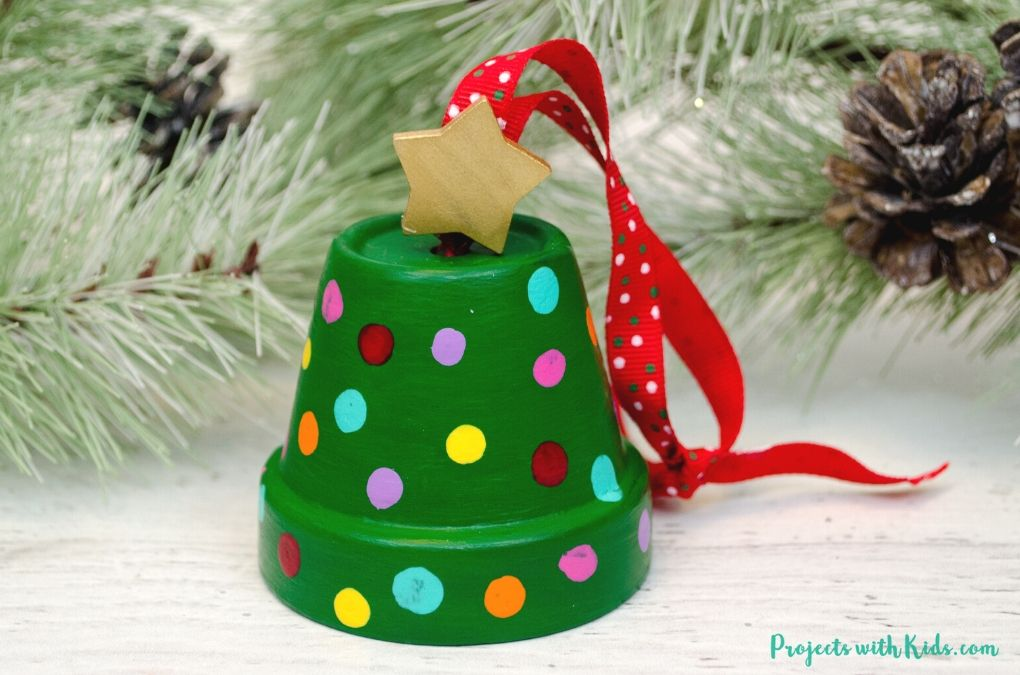 Clay pot Christmas tree ornaments with a gold painted wooden star on top and red ribbon to hang on the tree.