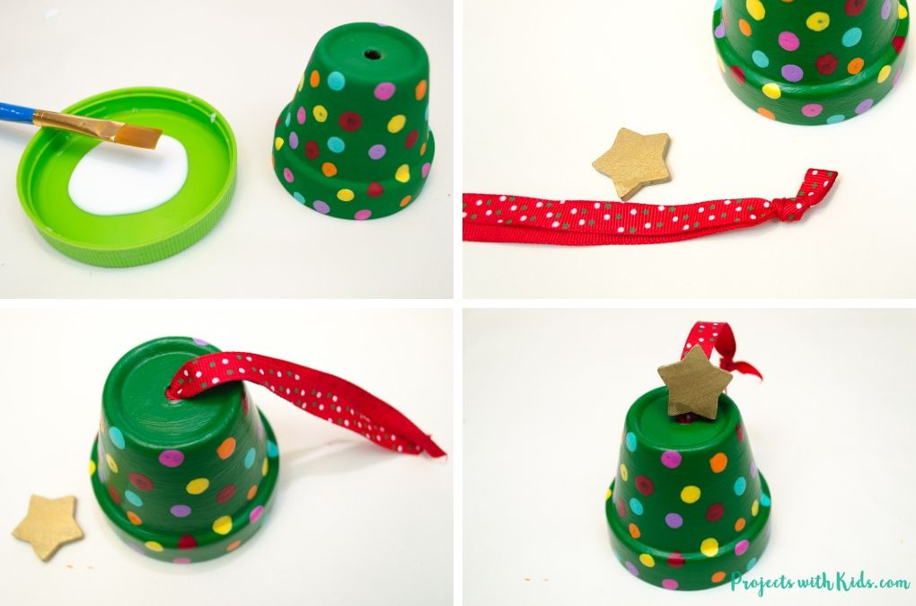 Adding a ribbon and gold painted wooden star to a mini clay pot that's painted to look like a Christmas tree.