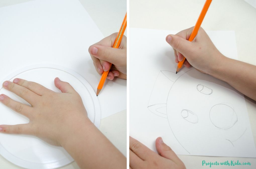 Drawing a reindeer with pencil on white paper.