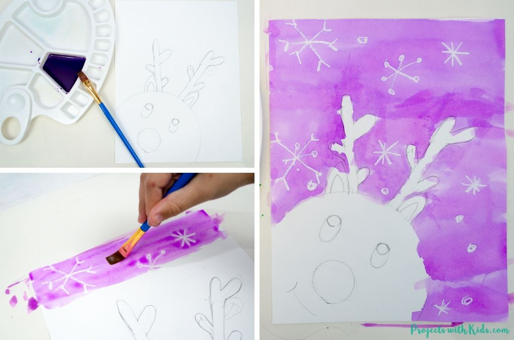 Painting purple watercolor on a reindeer painting